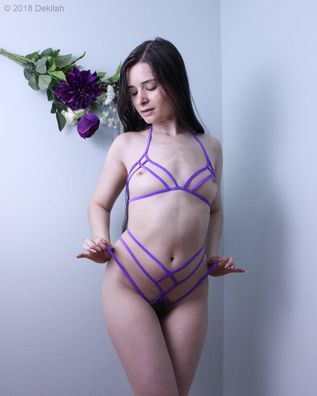 Dekilah nude in a purple body harness